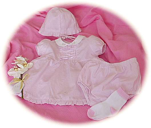 Baby's pink gingham dress